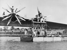 PHOTOGRAPH FB 33.   ENGINE MAINTENANCE ON PRINCESS FLYING BOAT