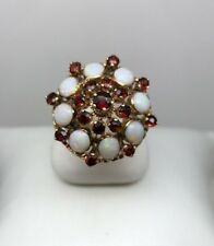 18K GOLD OPAL AND GARNET HAREM RING