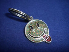 "Smiley face with tongue hanging out - Key chain,  1"" x 1 1/2"""