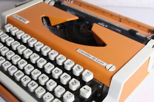 OLYMPIA Travellor De Luxe Typewrite + ORANGE + Black Case ~ Great Condition!