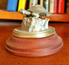 Small Metal Turtle on Wooden Stand