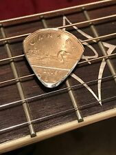 HAND CUT GUITAR PICK FROM A CANADIAN LOONIE COIN HAND CUT AND POLISHED