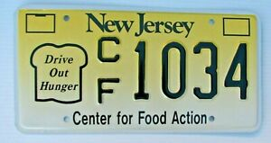 """MINT RARE! NEW JERSEY  LICENSE PLATE """" CF 1034 """" NJ DRIVE OUT HUNGER FOOD ACTION"""