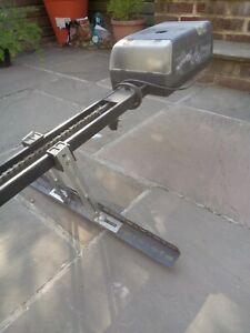 Henderson electric garage door opener with motor and mounting.