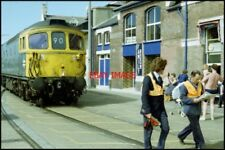 PHOTO  WEYMOUTH CLASS 25 DIESEL LOVE THE WAY THIS GUY IS READING HIS PAPER WITH