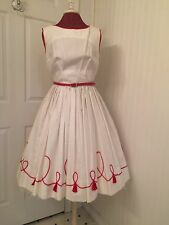 vintage 1950's white cotton dress with red tassels, full skirt