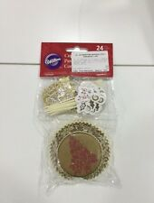WILTON 24 PIROTTINI CUPCAKE MUFFIN CON PICK DECORATIVO COLOR ORO E ROSSO NATALE