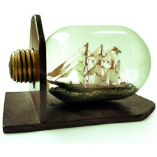 A BEAUTIFUL ANTIQUE FOLK ART CLIPPER SHIP IN BOTTLE / LIGHT BULB WITH STAND