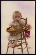 Cute BABY sitting on antique wooden HIGH CHAIR. Old Real Photo postcard FRANCE