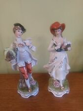 A pair of man and lady vintage china figurines