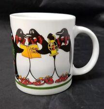 Penguins Coffee Mug: Christmas Caroling, Holidays, Penguin Child w Hockey Stick