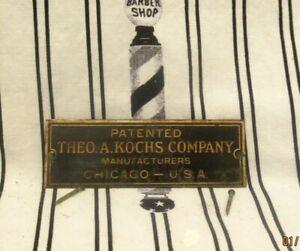 Original Theo Kochs Chicago Brass Nameplate Barber Chair Back Bar Shine Stand