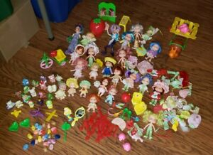 Large lot  of Vintage Strawberry Shortcake Dolls  and accessories