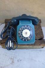 Ancien telephone à cadran bleu des années 70 80