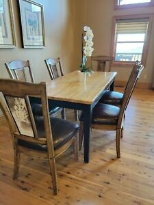 Custom made dining room table and matching custom cowhide/leather chairs
