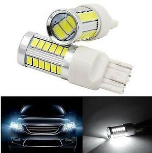 2 Ampoules T20 LED W21/5W Blanc 6000K Veilleuse Feux de jour Frein stop 12V 7443