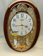 """RHYTHM"" MUSICAL WALL CLOCK - ""TRUMPET BOYS"" -W/ 16 MELODIES -CLARION TONE4MJ895"