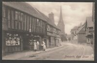 Postcard Petworth near Midhurst Sussex shops in East Street early view