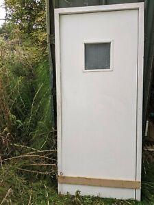 Fire door, frame, door stops, architrave, fire retardant inserts.