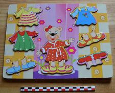 Puzzle en bois peint, très bon état, fille ourson à habiller
