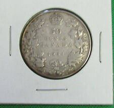 1931 Canada 50 Cents silver a nice coin Fine little scratches on observe