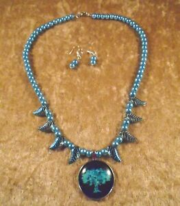 Tree of Life Cabochon on String of Blue Pearls with Blue Iridescent Leaf Accents