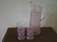 ANTIQUE FRENCH PINK GLASS WATER PITCHER WITH ENAMEL FLOWERS AND TWO GLASSES.