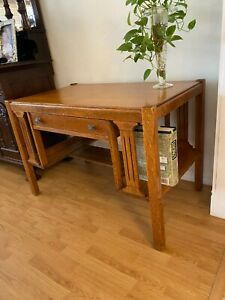 library desk solid wood, side built-in book cases good condition, very charming