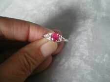Thai Ruby & Topaz ring, size N/O, 1.22 carats, 2.14 grams of 925 Sterling Silver