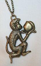 Delightful Textured Brasstone Frolicking Monkey Pendant Necklace