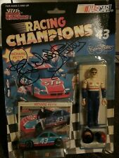 Richard Petty vintage signed Racing Champions car, card, and figure.