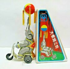 Circus Elephant On Bike Wind Up Tin Toy With Spinning Ball - (2575)