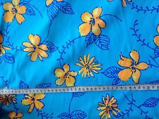 Turquoise fabric with orange floral pattern Lycra (4-way stretch) 323