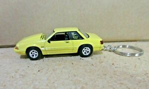 YELLOW 1988 FORD MUSTANG 5.0 COUPE  KEY CHAIN 1/64 SCALE