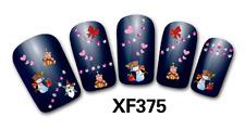 Nail art Stickers bijoux d'ongles: Pères Noel - coeurs - noeuds - bonhommes