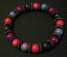 Great elasticated beaded bracelet with mulitcoloured beads and bronze spacers