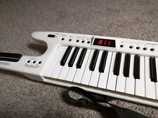 Roland AX-7 Keytar MIDI Controller, Battery Powered, White with strap