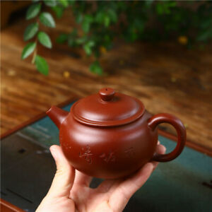 ball shaped infuser holes tea pot Chinese character carved pot marked dahongpao
