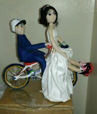 Personalised Polymer Clay Cake Topper - Couple on cycle with roller skates