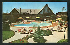 C1960s View: People by Pool. Holiday Inn Hotel near Dorval Airport, Canada