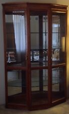 Wood And Glass Curio Cabinet With Interior Lighting And Mirrored Back