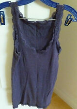 Two top tank with lace around neck and arm and at the bottom, moss green