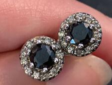 Black Diamond Earrings With Halo Diamonds Around.