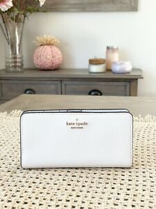 kate spade new york Darcy large slim bifold wallet In Parchment / Gold