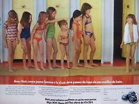 PUBLICITÉ 1974 HUIT TOUTE FEMME A DROIT DE SE PASSER DU HAUT DE MAILLOT DE BAIN