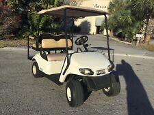 White 2015 GAS Ezgo txt 4 passenger flip seat golf cart lights turn signals