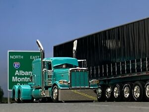 "1/64 DCP TEAL PETERBILT 389 W/ 63"" FLAT TOP SLEEPER"