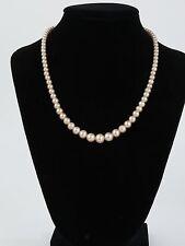 Faux pearl necklace strand simulated cream rhinestone bow silver tone clasp