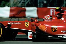 Kimi RAIKKONEN SIGNED Ferrari Driver Formula 1 Autograph 12x8 Photo AFTAL COA