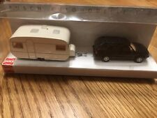 Busch HO Scale Black Sedan With Caravan #46493-002